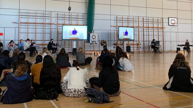 Students in the Sports Hall during a Colet Day assembly.